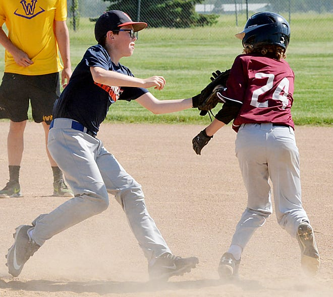 A base runner is tagged out in a rundown during the 2019 Watertown Baseball Association's Coca-Cola Tournament. The tourney was not held last year due to COVID-19 but returns this weekend with 46 teams in 7 divisions. Games will be played at Koch Complex, Foundation Fields and Watertown Stadium.