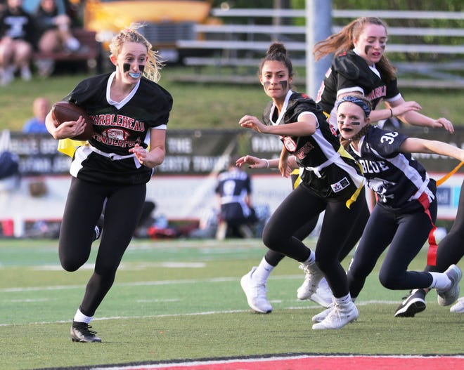 Marblehead running back Anna Rigby sees nothing but daylight ahead during last week's flag football game against rival Swampscott.
