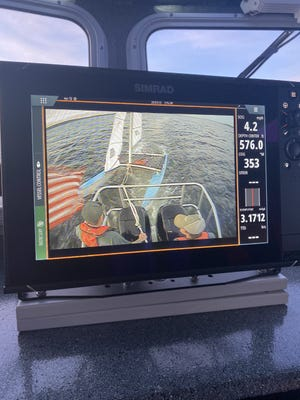 A view of a catamaran that flipped over on Monday, which drew North Kitsap Fire and Rescue responders, who rescued two men from Puget Sound.