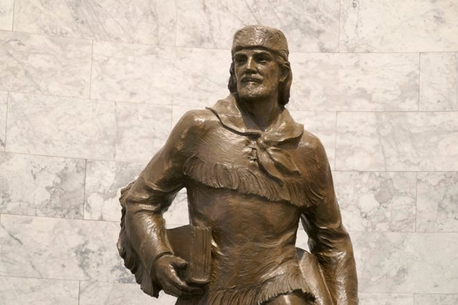 A statue of Marcus Whitman is displayed in the Legislative Building at the Capitol in Olympia.