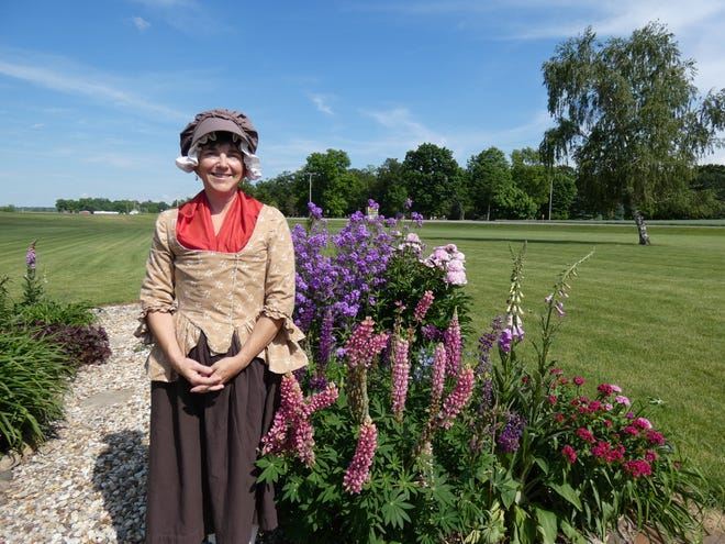 Julie Rossington stands in her garden east of Bucyrus. Rossington will be among the almost 60 reenactors at Living History Days at Lowe-Volk Park this weekend.