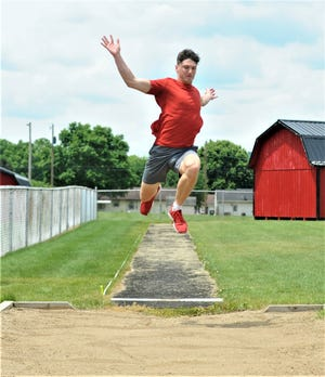 Coshocton junior Korbyn Haley practices the long jump on Tuesday in preparation for the Division II state track and field meet on Friday at Pickerington North. Haley won the regional title with a personal-best jump of 21-feet-0.