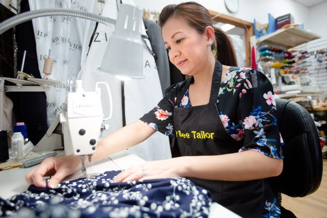 Hong Nguyen of Busy Bee Tailor works at her Des Moines business. Nguyen and her business are popular parts of the Beaverdale community.