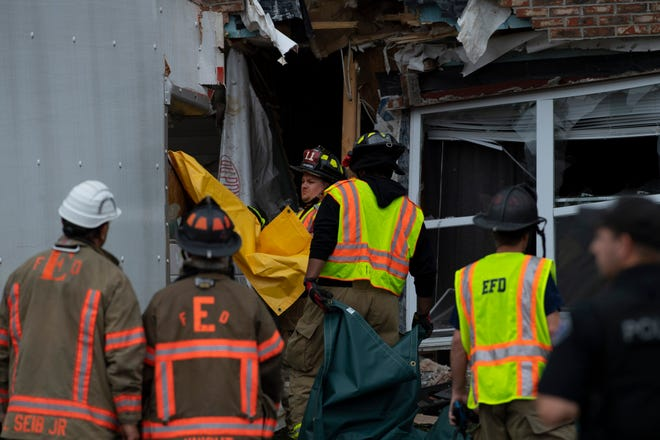 Emergency personnel work the scene of an accident at Canterbury House Apartments on Outer Lincoln Avenue., Tuesday afternoon, June 1, 2021. A delivery truck crashed into an apartment and killed the passenger. The driver was injured and transported to a hospital. The accident is under investigation.