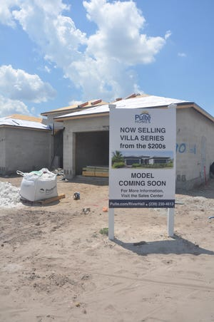 Construction is underway at River Hall of the new villas by Pulte. Sales people are excited to offer country club living from the low $200,000's.