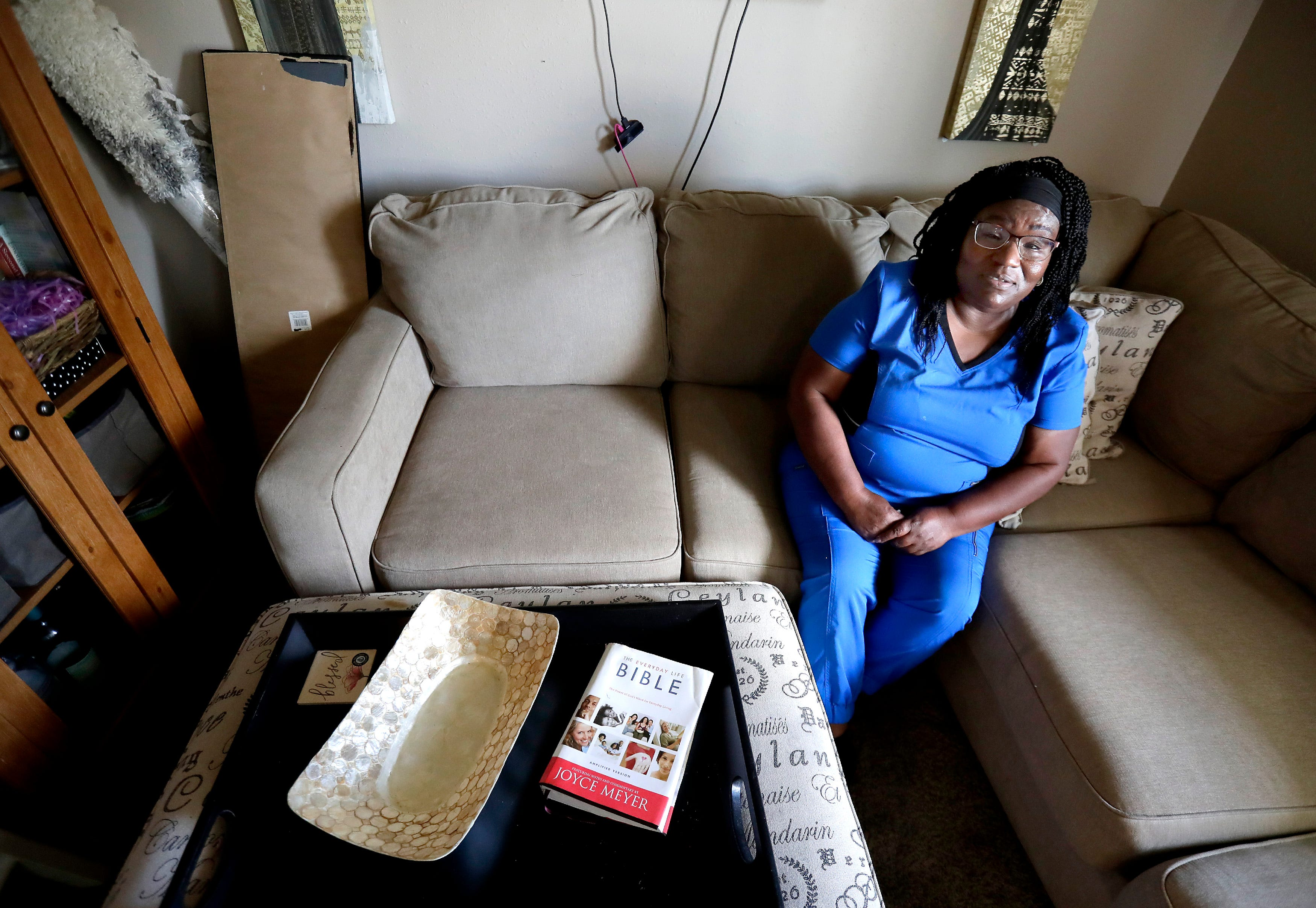 Marion Scott, pictured in her Oshkosh apartment, has looked without success for a larger two-bedroom apartment in Oshkosh. The 60-year-old single woman says landlords won't rent to her because of her past financial problems and racial discrimination.