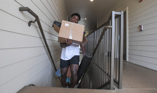 New Ragin' Cajuns linebacker KC Ossai moved in Tuesday with other UL freshmen football players for summer workouts.