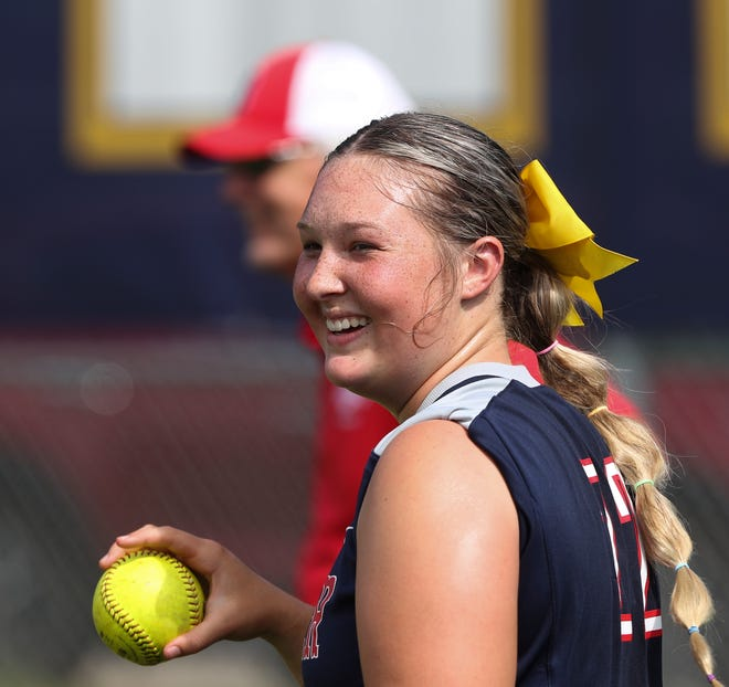 Butler High School softball player Emily Williams (22) warms up before their game against Male at the Male High School in Louisville, Ky. on May 27, 2021.  She often leads the team in a pre-game prayer ritual that honors Butler student Madelynn Troutt who passed away in March.