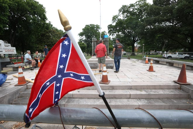 The Sons of Confederate Veterans work to exhume the remains of General Nathan Bedford Forrest from Health Sciences Park Tuesday, June 1, 2021. The remains will be transferred to the National Confederate Museum, on private land in Columbia, Tenn.