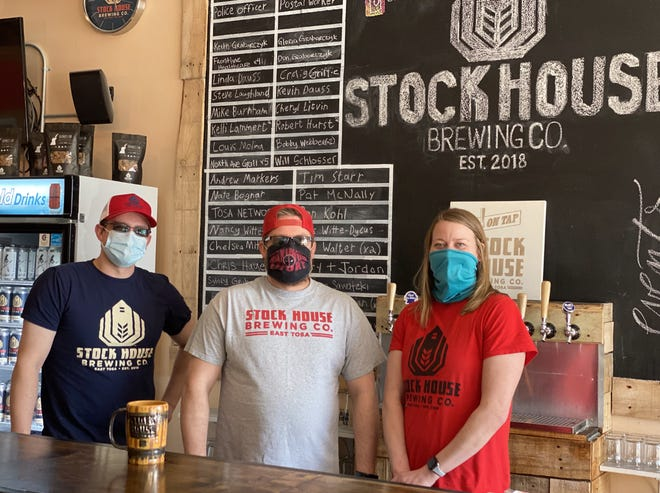 Brothers David, left, and Aaron Morrill, head brewer, center, work with owner Lori Sommerfeld at Stock House Brewing, 7208 W. North Ave., Wauwatosa.