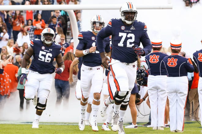 Auburn offensive lineman Prince Micheal Sammons (72) takes the field before a game against Liberty on Saturday, Nov. 17, 2018, in Auburn, Ala.