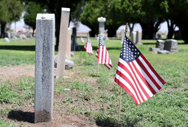 Flags flap in the breeze at Mountain View Cemetery. Legion members planted over 900 at veteran gravesites.