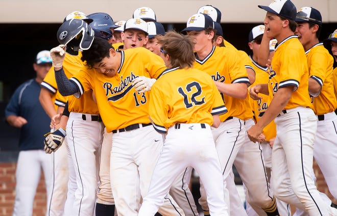 ELCO's Jeremy Eck (13) gets mobbed by his teammates at home plate after hitting a two-run homer to give the Raiders the lead in the sixth inning of a PIAA District 3 Class 4A semifinal game against Eastern York in Wrightsville on Tuesday, June 1, 2021. ELCO won, 3-2.
