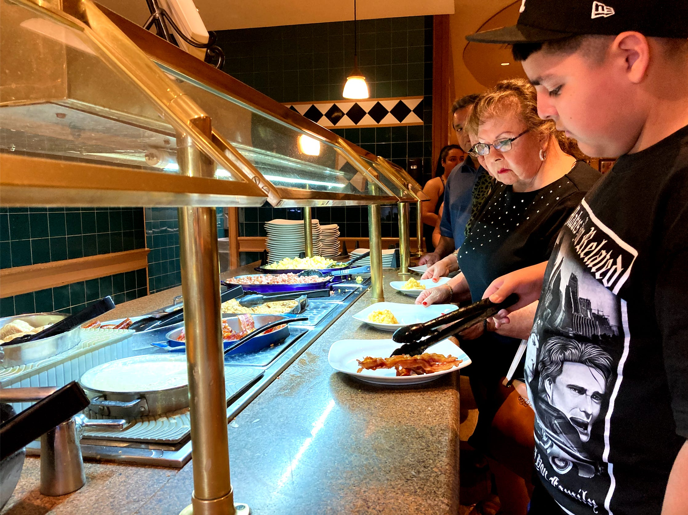 Las Vegas buffets are once again self-serve. But the 'buffet capital' isn't back to normal yet