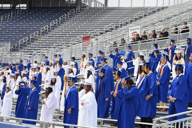 Fort Defiance High School is the only area public school still using gender-specific graduation gowns, with girls wearing white and boys wearing blue.