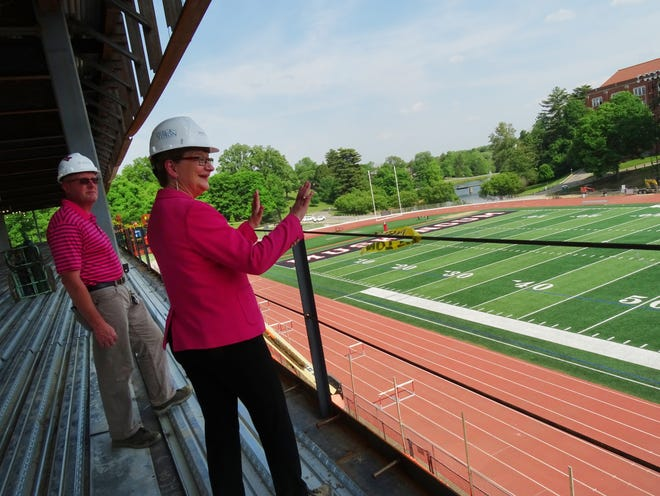 Facilities director Kevin Wagner accompanies Muskingum University President Susan Hasseler on a walkthrough of the university's new Health and Wellness Complex on May 25, 2021. They overlook the football field from the $1.1 million Straker Grant-aided wellness corridor, a portion of the facility that'll offer educational opportunities.