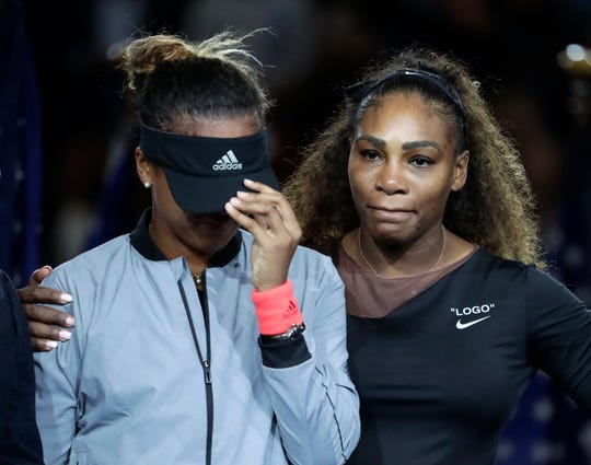 Serena Williams comforts Naomi Osaka after Osaka defeated her in the women's final of the U.S. Open tennis tournament on Sept. 8, 2018, in New York.