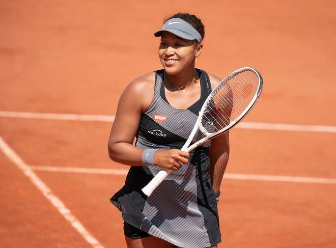 Naomi Osaka reacts during her match against Patricia Maria Tig at Roland Garros Stadium.