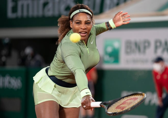 Serena Williams plays a backhand during her first-round match against Romania's Irina-Camelia Begu.