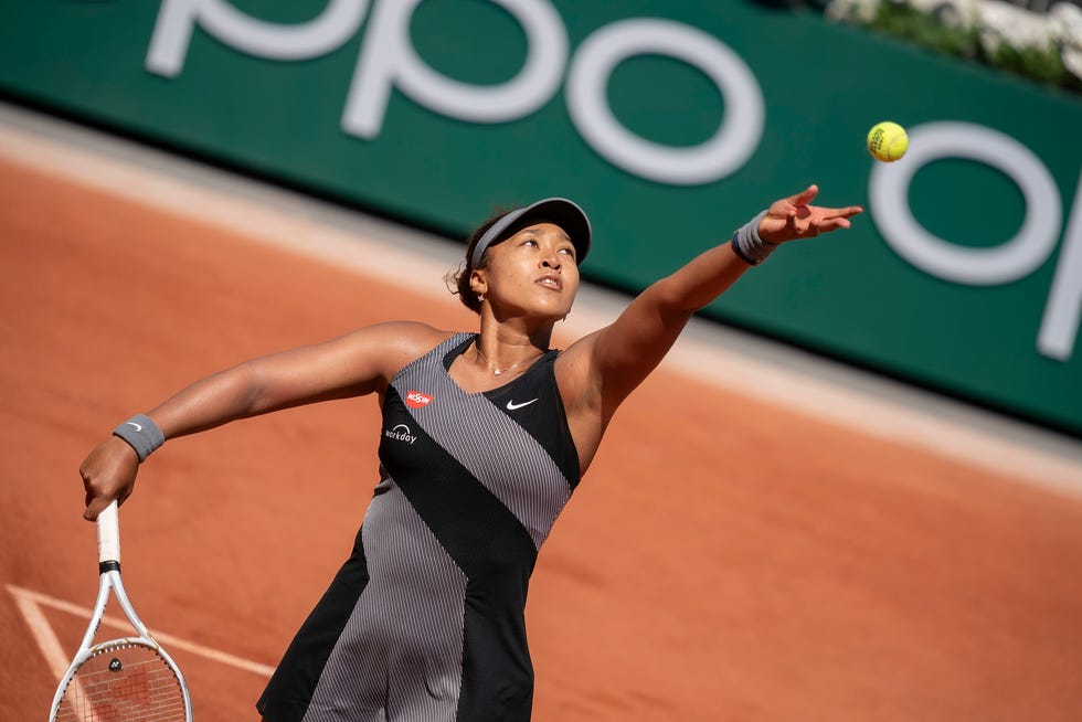 Naomi Osaka beats Patricia Maria Tig in the first tround of the French Open on Monday before withdrawing from the tournament.