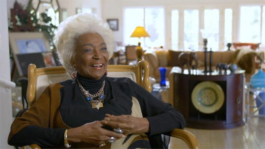 """Actress Nichelle Nichols, who played Uhura on """"Star Trek: The Original Series,"""" laughs in a scene from the documentary """"Woman In Motion,"""" streaming June 3 on Paramount+."""