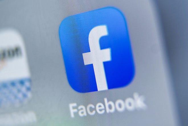 Facebook logo displayed on a tablet