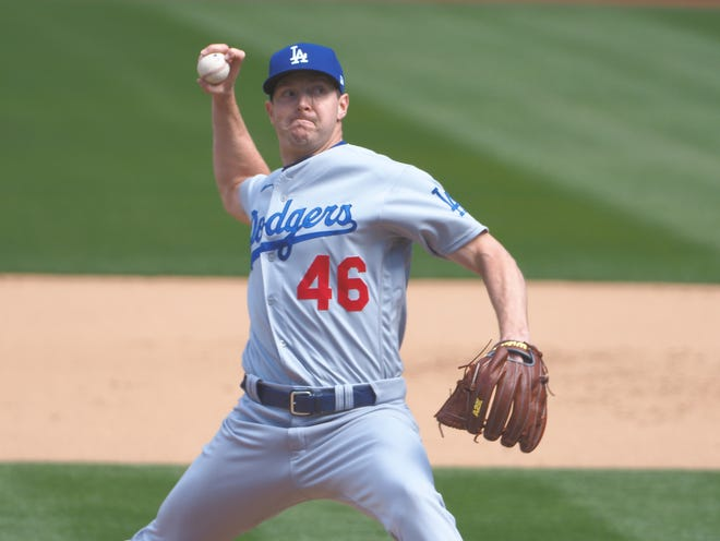Los Angeles Dodgers relief pitcher Corey Knebel deals to the plate versus the Oakland Athletics in a game earlier in the 2021 season. The former Bastrop and Georgetown relief pitcher made eight appearances this season before getting injured.