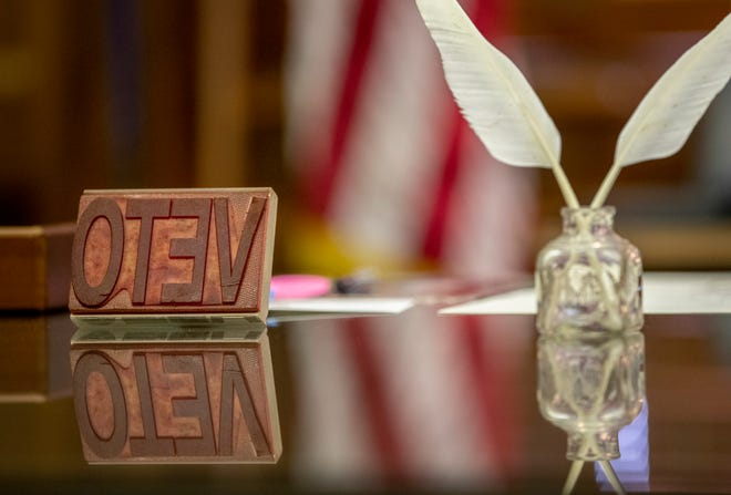A veto stamp is on the desk of Gov. Greg Abbott in his office at the Capitol on Wednesday on June 2, 2021.