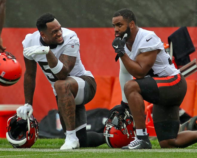 Cleveland Browns linebacker Mack Wilson, left, chats with teammate Anthony Walker Jr. on the sideline during an NFL Football OTA, Wednesday, June 2, 2021, in Berea, Ohio.