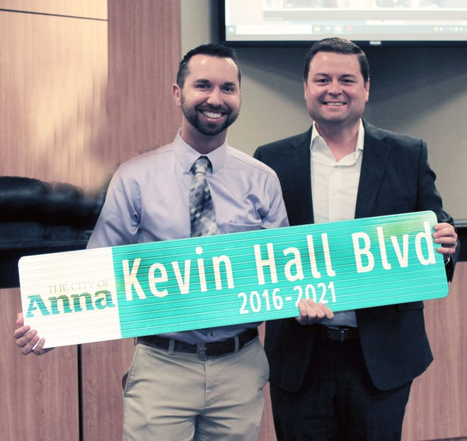 The Anna City Council presented outgoing Chamber of Commerce President and CEO Kevin Hall a ceremonial street sign in recognition of his service to the city.