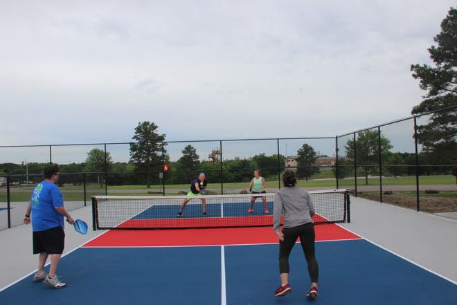 Experienced pickleball players demonstrate the game after a ribbon cutting ceremony for the new pickleball courts at Regional Park. From left to right Tes Stewart, Jerry McMahon, Andrea Anderson and Kelly Hobbs.