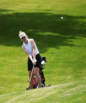 Roland-Story's Ellie Erickson chips a shot onto the 18th hole green during the first day of Class 2A girls' state golf competition Tuesday at the American Legion Golf Course in Marshalltown. The Norse ended the first day tied for second in the team standings after 18 holes with a score of 356.