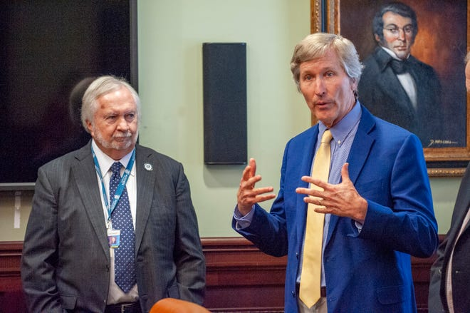 Augusta University President Brooks Keel, left, listens as Dean of the Medical College of Georgia David C. Hess talks about the CONGA study during a check presentation to fund it at Augusta University in Augusta, Ga., June 2, 2021.
