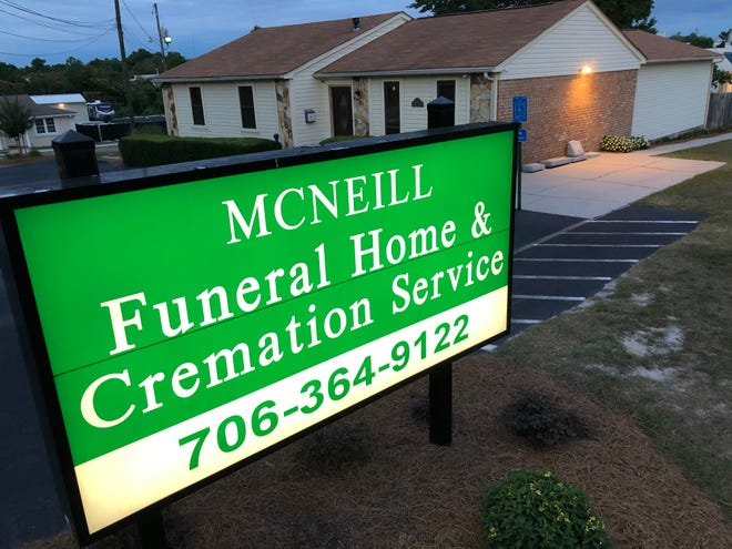 Columbia County commissioners denied a zoning variance request to McNeill Funeral Home that would have allowed the construction of an onsite crematory.