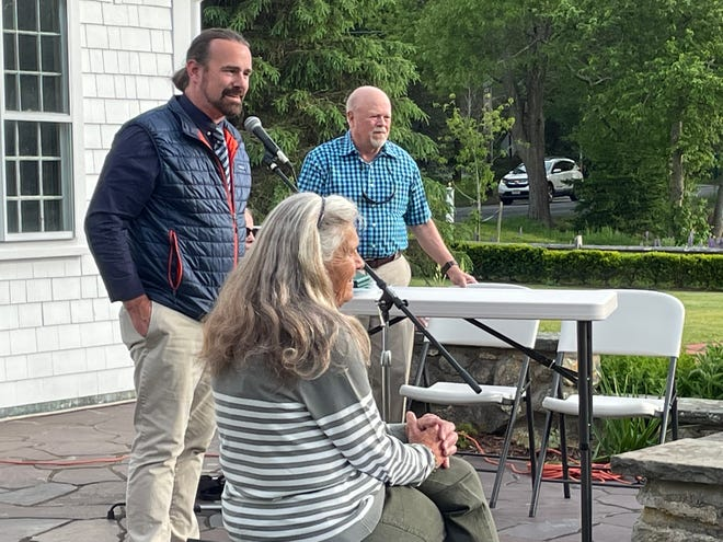 Barmstable Town Council President Matt Levesque welcomes neighbors to Tuesday night's meeting of the Marstons Mills Village Association as Donna Lawson and Larry Rhue look on.