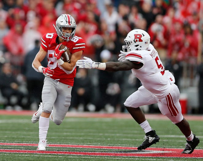 Ohio State Buckeyes wide receiver C.J. Saunders (80) returns a punt against Rutgers Scarlet Knights linebacker Trevor Morris (5) during the second quarter of the NCAA football game between Ohio State and Rutgers at Ohio Stadium on Saturday, September 8, 2018.  [Jonathan Quilter/Dispatch]