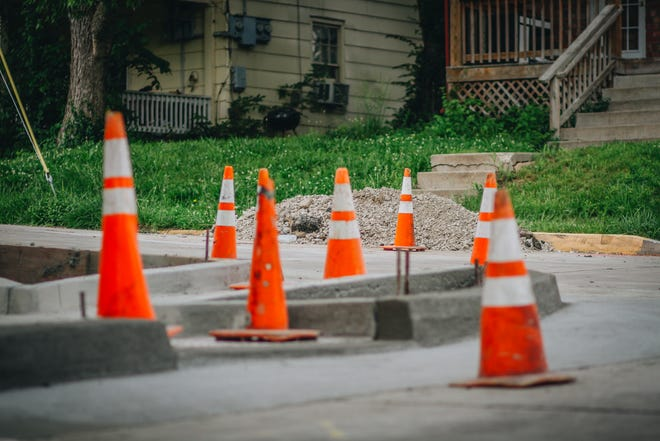 Cones block off certain parts of the sidewalk on North William Street in Columbia.