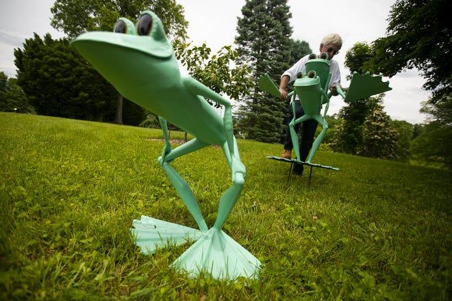 "Artist J.A. Cobb of North Carolina installs part of ""Ribbit the Exhibit"" at The Dawes Arboretum."