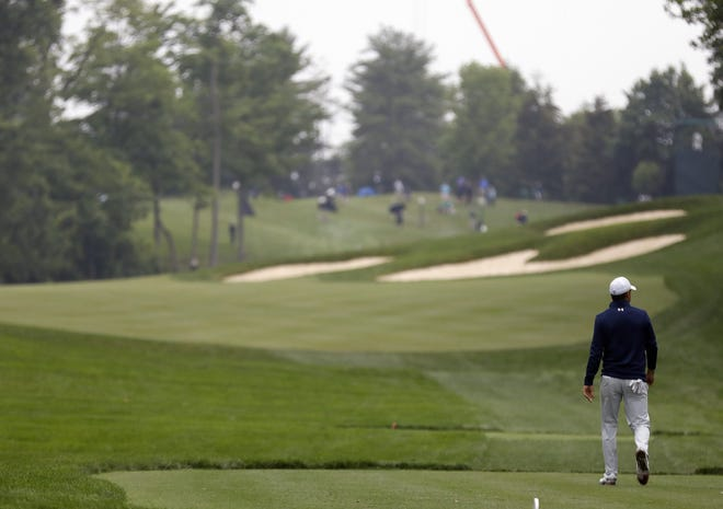 Jordan Spieth heads up the No. 15 fairway at Muirfield Village Golf Club after hitting his drive in Wednesday's pro-am. The hole is the one perhaps most dramatically redesigned in a project that started after last year's Memorial Tournament ended.