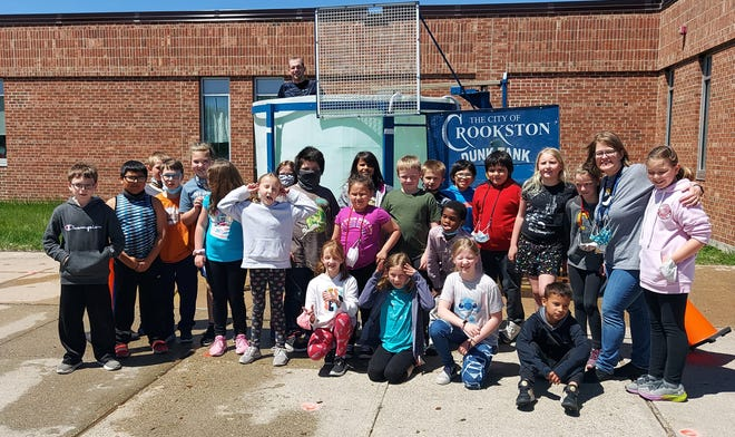 Mrs. Ingersoll's class pose while Superintendent Jeremy Olson looks up from the dunk tank