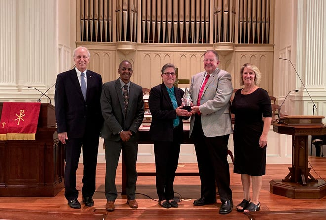 Rev. Lynda Ferguson (center) is honored to receive the Ray of Light award, recognizing inclusivity.