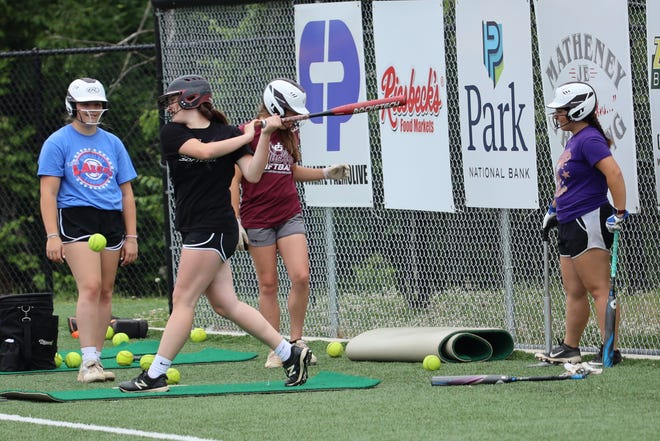 Members of the John Glenn Lady Muskies softball team get in some work Wednesday morning at John Glenn High School. The Lady Muskies will be taking on LeGrange Keystone on Friday in Division II state semi-final action at Akron's Firestone Stadium.