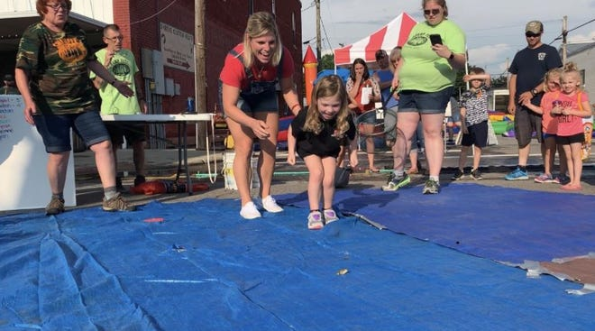 Rylee Whitworth cheers on her frog during the first annual frog-jumping contest at the 2019 Shreve Swampfest.
