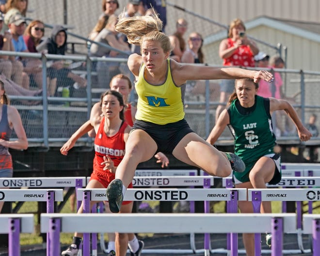 Madison's Carly Anschuetz runs during the high hurdles at Tuesday's Lenawee County Championships at Onsted.