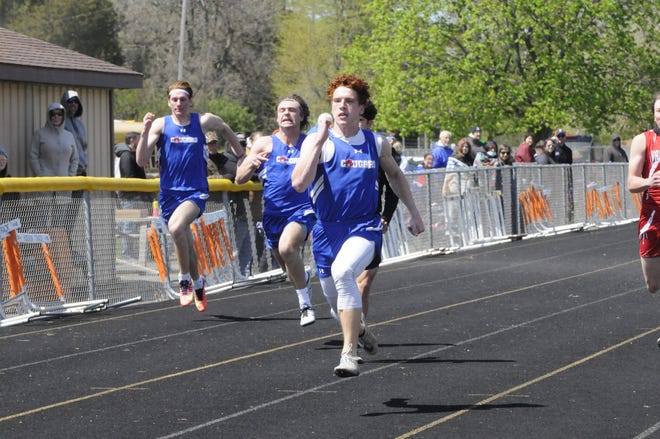 Lenawee Christian's Jameson Chesser runs during the 100-meter dash at a meet in Hudson earlier in the 2021 season.