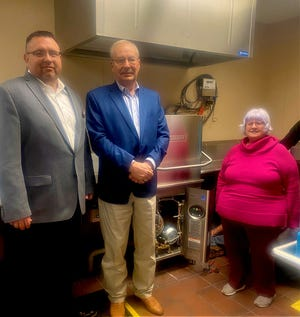 Ryan Ausmus, board member of the Community Foundation of Southwest Kansas; Pat Hamit, executive director of the Community Foundation awarded a grant of $18,000 for the Depot Theater to go towards a new dishwasher for the facility to Nancy Sapp, president of the Depot Theater Board of Directors.
