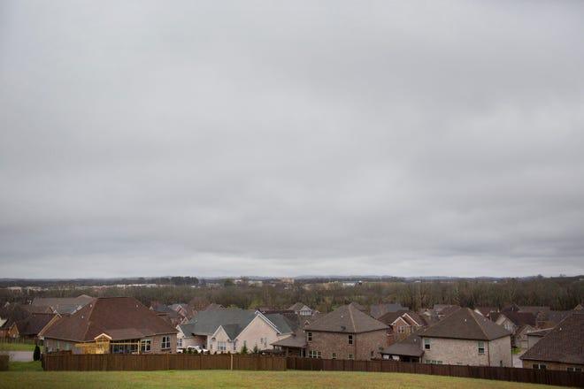 A cloudy sky covers a neighborhood in Spring Hill, Tenn., on Tuesday, Feb. 11, 2020.