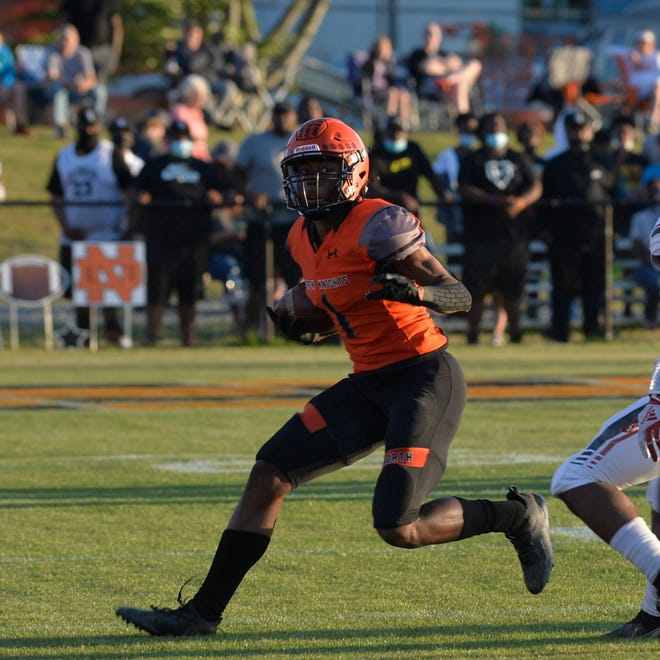 North Davidson's Jamarien Dalton looks to turn the corner in the 2-AA state semifinals against Salisbury. Dalton has been named the spring 2021 Dispatch All-Davidson County Offensive Player of the Year. [Mike Duprez/The Dispatch]