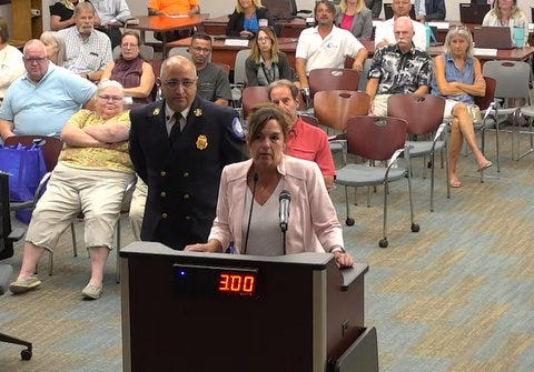 Denise Bevan (at the podium) was unanimously selected on Tuesday as the interim Palm Coast city manager.