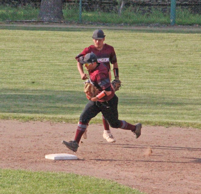 Union City senior Connor Elgan steps on second for an out in front of teammate Tyler Wagley Tuesday versus Hillsdale